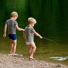 Two boy's playing in a lake.